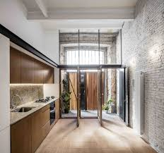 this double height apartment in barcelona features historic