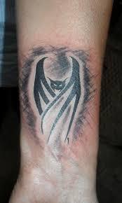 tribal bat tattoo designs on arm batman tattoos vampire bat