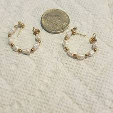 14 karat gold earrings vintage estate 14 karat gold pearl hoop earrings from tamara s