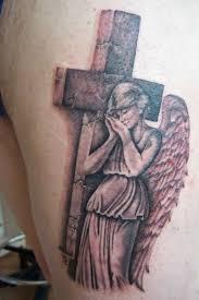 sweet winged angel with christian cross tattoo tattooshunter com