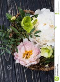 peony flowers arrangement on old wooden board background festiv