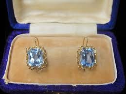 topaz earrings fourteen karat yellow gold and blue topaz earrings dated at about