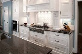 white mozaic tile backsplash kitchens with dark cabinets and light