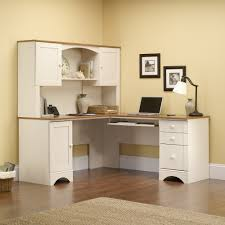high white wooden corner desk with shelf on the middle of storage