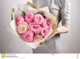 flowers for s day florist girl with peony flowers or pink garden roses woman