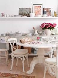 shabby chic kitchen with dining table and chair also flower vase