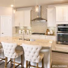 natural wood accents paired with a full wall backsplash make this