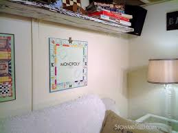 Game Room Basement Ideas - easy way to hang board game art