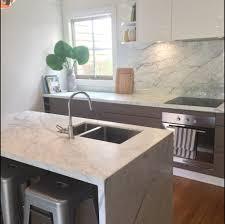 cabinets surrounding refrigerator tags granite kitchen benchtops