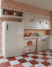 awesome cool retro steel kitchen cabinets design with red combination white tile floor decorating ideas and white stainless refrigerator on the floor also