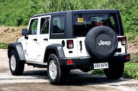 is a jeep wrangler worth it jeep wrangler unlimited sport vs toyota fj cruiser top gear