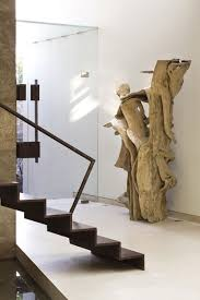 glass doors wooden sculpture stairs modern family home in