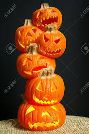 jack o lanterns halloween decoration a stack of pumpkins