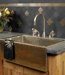 sinks metallic and stone tile backsplash metallic three holes