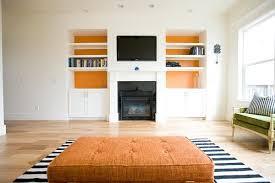 Orange Ottoman 10 Ways Ottomans Can Enhance A Room Freshome