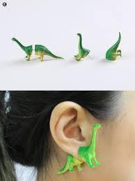 dinosaur earrings upcycled dinosaur earrings ooo workshop