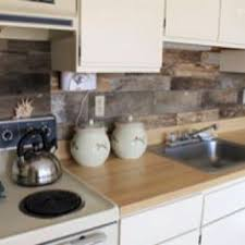 cheap backsplash ideas for the kitchen cheap barnboard diy rustic kitchen backsplash i been