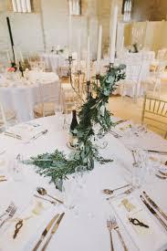 Table Decor Stylish Meets Rustic Hand Made Winter Wedding Greenery
