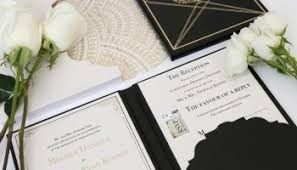 black and gold art deco wedding invitation suites by atelier