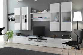 Tv Storage Units Living Room Furniture A Bright Living Room With White Cabinets One Low With Doors And
