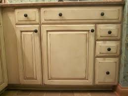 Rustic White Kitchen Cabinets - tiny distressed white kitchen cabinets with round black hardware