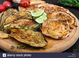 patisson cuisine baked vegetables eggplant patisson tomatoes on a wooden
