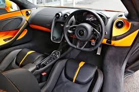 orange mclaren interior mclaren 570 s hire from sportscarhire sports car hire