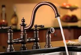 how to change a kitchen faucet with sprayer installing a kitchen faucet and side sprayer at the home depot