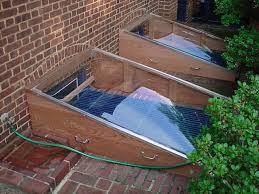 basement window well how window well covers can protect your basement from leaks