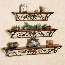 three tier wall shelf made of bronze polished metal based frame