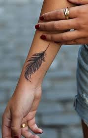 best 25 feather tattoo wrist ideas on pinterest feather tattoos