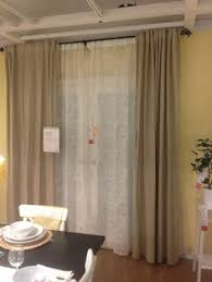 Drapes Over French Doors - beige curtains over french door window treatment ideas