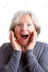 looking with grey hair surprised elderly woman with grey hair looking happy stock photo