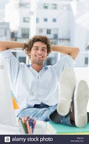 Legs On Desk Relaxed Casual Man With Legs On Desk In Office Stock Photo