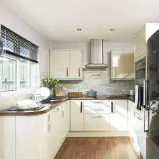 cream kitchen tile ideas euro gloss kitchen featuring under cabinet lighting latvia