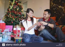 couple giving each other christmas gifts stock photo royalty free