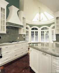 White Kitchen Dark Floors by Kitchen Brown Hanging Lamp Brown Tile Flooring White Wood