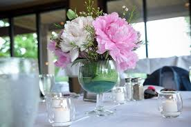 this wedding table centerpiece in a large wine glass type vase