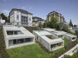 Slope House 4 Semi Subterranean Townhouses Set Into Sloping Hillside