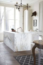 marble island kitchen white with grey vein island and rich brown wood floors kitchen