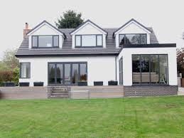 exterior large glass windows with mansard roof also brick wall