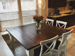 square baluster table in farmhouse style kitchen with x back