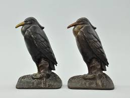 decorative door stops a set of cast iron crow bookends or doorstops 09 24 09 sold 235 75