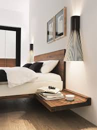 wood floating bed frame with white bedding of white bedroom design