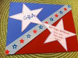 handmade stars in red and blue color of birthday card saying love