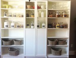 billy ikea bookshelves organizing pantry with baskets and glass