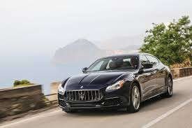 red maserati quattroporte behind the wheel of the muscular new maserati quattroporte maxim