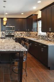 brown kitchen cabinets with backsplash cabinets with white granite countertops countertopsnews