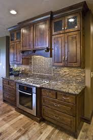 rustic kitchen cabinets with glass doors charming rustic knotty alder kitchen cabinets with high wall