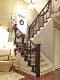 wooden staircase and railing big bows to hold the garland to